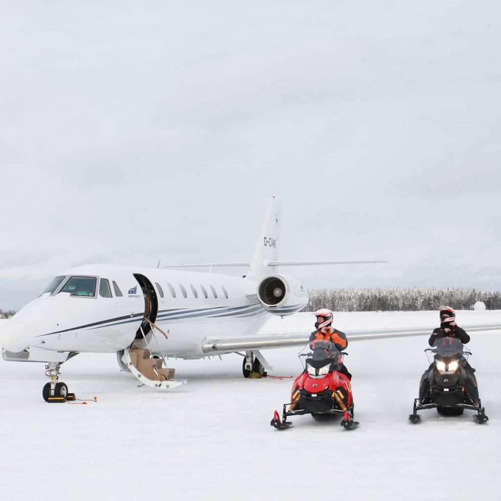 Private jet and snowmobiles